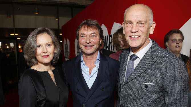 """Nicoletta Peyran, Lionsgate Motion Picture Group Co-Chairman Patrick Wachsberger and John Malkovich attend the LA Premiere of """"Warm Bodies"""" at the ArcLight Cinerama Dome on Tuesday, Jan. 29, 2013 in Los Angeles, California. (Photo by Todd Williamson/Invision for The Hollywood Reporter/AP Images)"""