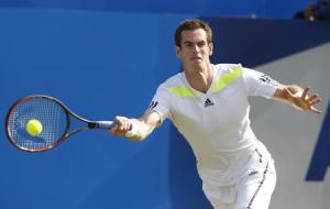 Britain's Andy Murray returns the ball to Czech Republic's Radek Stepanek during their match at the Queen's Club Championships in west London