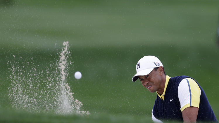 Tiger Woods hits out of a bunker on the 13th hole during the second round of the Honda Classic golf tournament, Friday, March 1, 2013, in Palm Beach Gardens, Fla. (AP Photo/Wilfredo Lee)