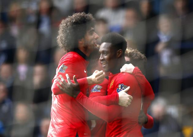 Manchester United's Welbeck celebrates with team mate Fellaini after scoring a goal during their English Premier League soccer match against West Bromwich Albion at The Hawthorns in West Bromwich