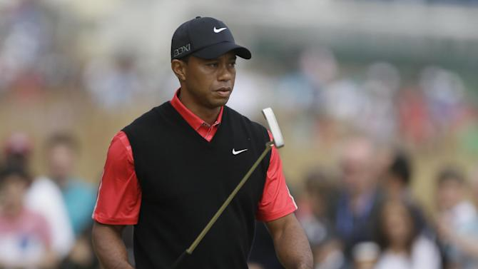 Tiger Woods of the United States walks off the practice putting green prior to his final round of the British Open Golf Championship at Muirfield, Scotland, Sunday July 21, 2013. (AP Photo/Jon Super)