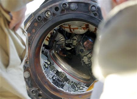 Russian cosmonaut Vinogradov is seen inside a Soyuz capsule shortly after it landed near the town of Zhezkazgan