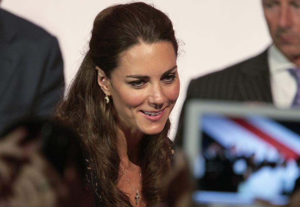 "Kate, the Duchess of Cambridge, smiles as she speaks with members of the crowd at the Service Nation: Mission Serve ""Hiring Our Heroes Los Angeles"" job fair event at Sony Pictures Studios, Sunday, July 10, 2011, in Culver City, Calif. (AP Photo/Bret Hartman)"