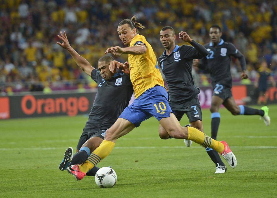 England's Glen Johnson tries to stop Sweden's Zlatan Ibrahimovic during the Euro 2012 soccer championship Group D match between Sweden and England in Kiev, Ukraine, Friday, June 15, 2012. (AP Photo/Martin Meissner)
