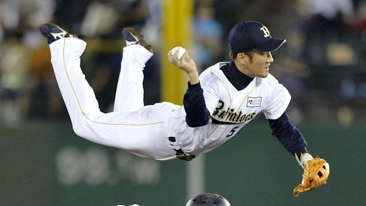 Orix BlueWave second baseman Keiichi Hirano jumps over second base after forcing out Chiba Lotte Marines' Daichi Suzuki, bottom, in the sixth inning of their Pacific League professional baseball game in Kobe, western Japan, Thursday, Aug. 28, 2014. (AP Photo/Kyodo News) JAPAN OUT, CREDIT MANDATORY