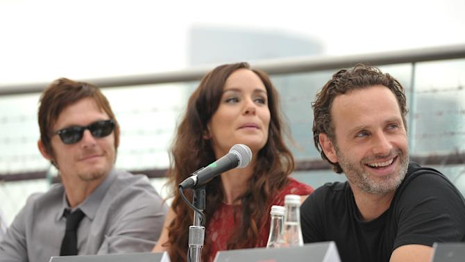 """COMMERCIAL IMAGE -  Norman Reedus, Sarah Wayne Callies and Andrew Lincoln at AMC's """"The Walking Dead"""" Fox Breakfast on Friday July 13, 2012, in San Diego. (Photo by John Shearer/Invision for AMC/AP Images)"""