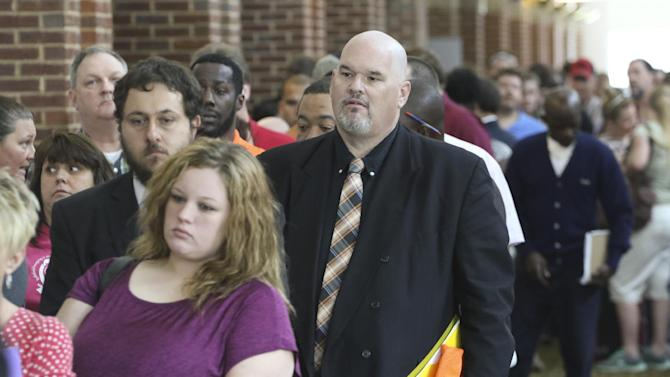 In this April 2, 2015 photo, David Dunn from Chickamauga, Ga., right, stands in line with hundreds of other job seekers at The Colonnade in Ringgold, Ga. to attend a huge 15-county job fair. Payroll processor ADP reports how many jobs private employers added in April on Wednesday, May 6, 2015. (Dan Henry/Chattanooga Times Free Press via AP) THE DAILY CITIZEN OUT; NOOGA.COM OUT; CLEVELAND DAILY BANNER OUT; LOCAL INTERNET OUT