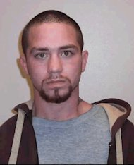 <p>               In this undated photo taken by the Washington state Department of Corrections and provided by the Port Angeles Police Department, Travis A. Nicolaysen is seen. The Port Angeles man is on the lam but still updating his Facebook page. Nicolaysen, 26, escaped from officers in two foot chases Wednesday, April 4, 2012, and a dragnet that included a police dog tracking him through a residential neighborhood. The Peninsula Daily News reports he's been convicted of five felonies, including domestic violence, burglary and theft of a firearm. (AP Photo/Department of Corrections)