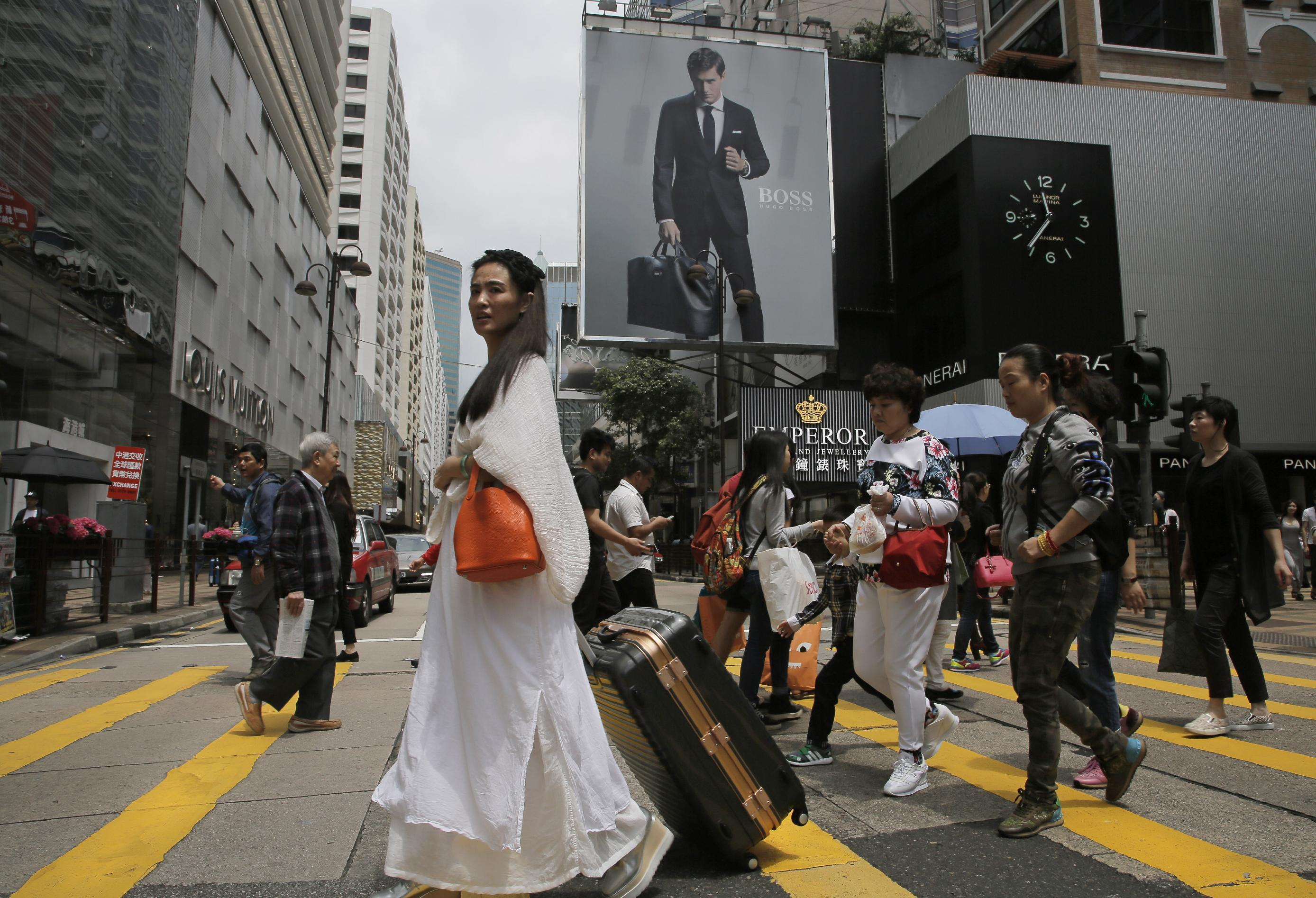 Defiant Hong Kongers resist embrace of mainland China