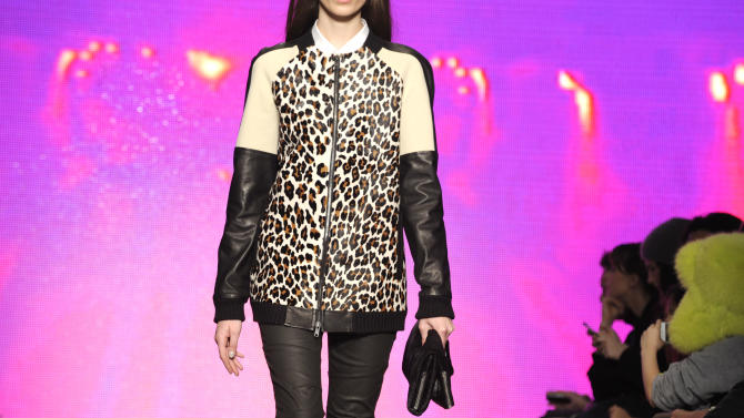 The DKNY Fall 2013 collection is modeled during Fashion Week, Sunday, Feb. 10, 2013, in New York. (AP Photo/Louis Lanzano)