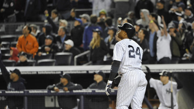 New York Yankees' Robinson Cano watches his grand slam off Detroit Tigers relief pitcher Al Alburquerque in the sixth inning during the continuation of Game 1 of baseball's American League division series on Saturday, Oct. 1, 2011, at Yankee Stadium in New York. (AP Photo/Kathy Kmonicek)