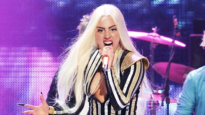 FILE - This Dec. 15, 2012 file photo shows singer Lady Gaga performing at the Prudential Center in Newark, N.J. Lady Gaga's tour confirmed Tuesday, Feb. 12, 2013, that the singer has postponed performances in Chicago, Detroit and Canada from Feb. 13 - Feb. 17, due to a severe inflammation of joints.  (Photo by Evan Agostini/Invision/AP, file)