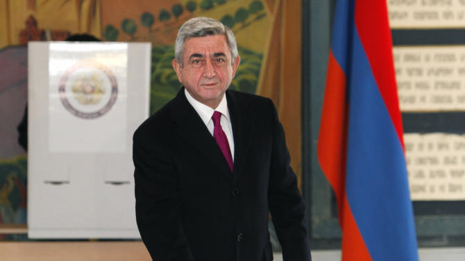 Armenian President Serge Sarkisian casts his ballot during presidential election in Yerevan, Armenia Monday, Feb. 18, 2013. For all that, incumbent Serge Sarkisian is widely expected to cruise through Monday's voting easily, likely getting the 50 percent plus one vote tally necessary to avoid a second round. Six other candidates are on the ballot. (AP Photo/PanARMENIAN Photo, Tigran Mehrabyan)