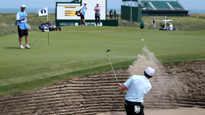 Justin Leonard of the U.S. hits out of a bunker on the 10th hole during a practice round ahead of the British Open Golf Championship at Royal St George's golf course in Sandwich, England, Monday, July 11, 2011. (AP Photo/Tim Hales)