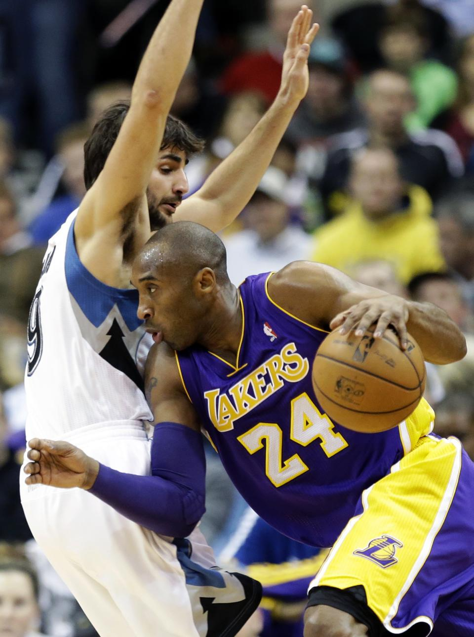 Los Angeles Lakers' Kobe Bryant, right, drives around Minnesota Timberwolves' Ricky Rubio, of Spain, in the first quarter of an NBA basketball game, Friday, Feb. 1, 2013, in Minneapolis. (AP Photo/Jim Mone)