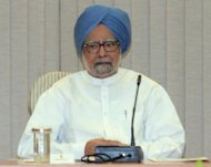 "Indian Prime Minister Manmohan Singh, pictured here in September, said that his government ""bit the bullet"" when introducing recent reforms, including to the retail sector that will allow global chains such as Walmart to open branches in India"