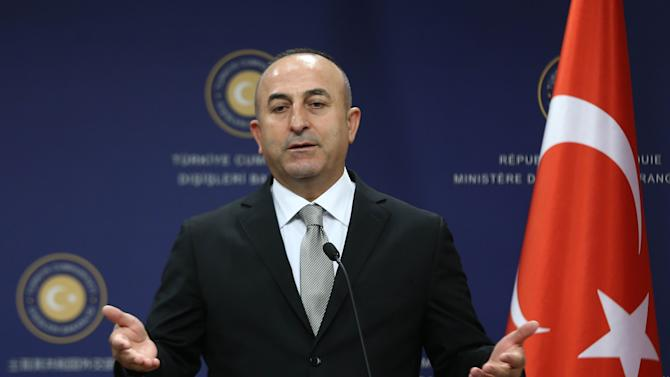 Turkish Foreign Minister Mevlut Cavusoglu speaks during a press conference on November 18, 2014 in Ankara
