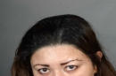 This undated law enforcement booking photo provided by the Los Angeles Police Department shows Veronica Aguilar, 39. Aguilar has been charged with murder in the death of her severely malnourished 11-year-old son Yonatan, whose body was found wrapped in a blanket in a closet in their Los Angeles home Monday, Aug. 22, 2016. Aguilar was charged Thursday, Aug. 25, with one count each of murder and child abuse in the death of her son. (Los Angeles Police Department via AP)