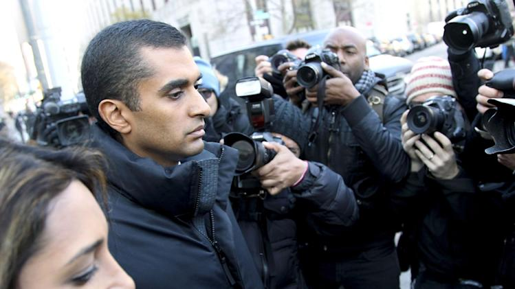 Mathew Martoma is surrounded by media as he leaves the federal courthouse in New York, Monday, Nov. 26, 2012.  Martoma, accused of enabling a quarter of a billion dollars in profits through inside information, appeared in a New York court Monday for the first time and was released on $5 million bail after his 12-minute appearance before a federal magistrate judge. (AP Photo/Seth Wenig)