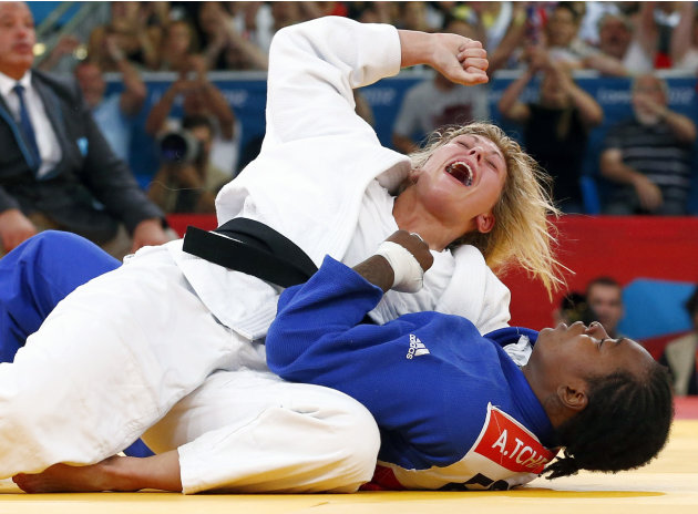 Britain's Gemma Gibbons celebrates defeating France's Audrey Tcheumeo in women's -78kg semi-final judo match at London 2012 Olympic Games