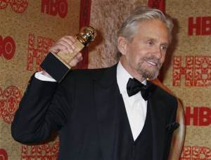 """Actor Douglas holds the Golden Globe Award he won as Best Actor, Miniseries or Movie, for his role in HBO's """"Behind the Candelabra"""" at the HBO after party, after the 71st annual Golden Globe Awards in Beverly Hills"""