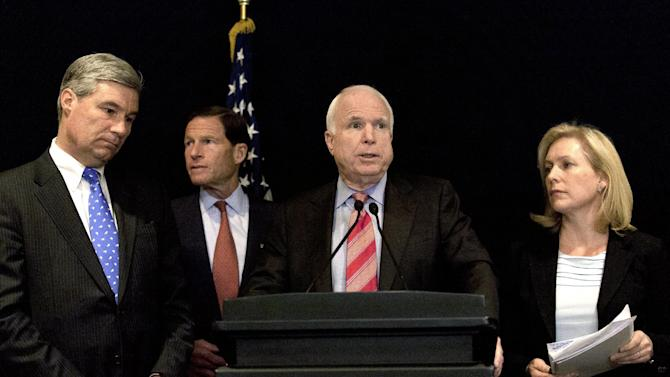 "From left, Senators, Sheldon Whitehouse, Democrat from Rhode Island, Richard Blumenthal, Democrat from Connecticut, John McCain, Republican from Arizona and Kristen Gillibrand, Democrat from New York, attend a press conference for a delegation from the United States Senate, in Cairo, Egypt, Wednesday, Jan. 16, 2013.  Egypt's Islamist president tells visiting U.S. senators that his past remarks calling Zionists ""pigs"" and ""bloodsuckers"" were a denunciation of Israeli policies not an attack on Jews, hoping to defuse Washington's anger over the comments. (AP Photo/Nasser Nasser)"