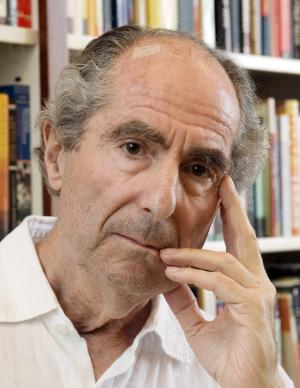 "FILE - In this Sept. 8, 2008 file photo, author Philip Roth poses in the offices of his publisher Houghton Mifflin, in New York. Roth, the American author of the 1960s cultural touchstone ""Portnoy's Complaint"" and more than two dozen other novels, was named Wednesday, May 18, 2011, as the winner of the Man Booker International Prize for fiction. The prize is awarded every two years to a living writer for overall contribution to fiction. (AP Photo/Richard Drew, File)"