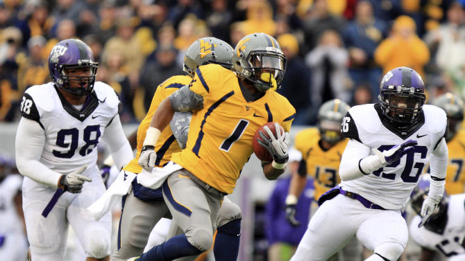 West Virginia receiver Tavon Austin (1) carries the ball for a touchdown during the first half of their NCAA college football game against TCU in Morgantown, W.Va., on Saturday, Nov. 3, 2012. (AP Photo/Christopher Jackson)