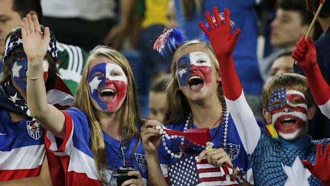 American fans cheer for their team before the group G World Cup soccer match between Ghana and the United States at the Arena das Dunas in Natal, Brazil, Monday, June 16, 2014