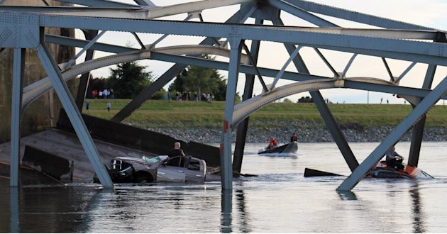 In this photo provided by Francisco Rodriguez, a rescue boat approaches the scene where a pickup truck and a car fell into the Skagit River after the collapse of the Interstate 5 bridgeThursday, May 2