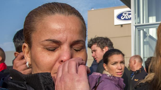 A Ford worker reacts after the European Ford management announced it would close the Ford plant in Genk, Belgium on Wednesday Oct. 24, 2012. A union leader says Ford has decided to close its factory in Genk, Belgium, at the end of 2014 in a move that will result in 4,500 direct job losses and 5,000 more among subcontractors. (AP Photo/Geert Vanden Wijngaert)