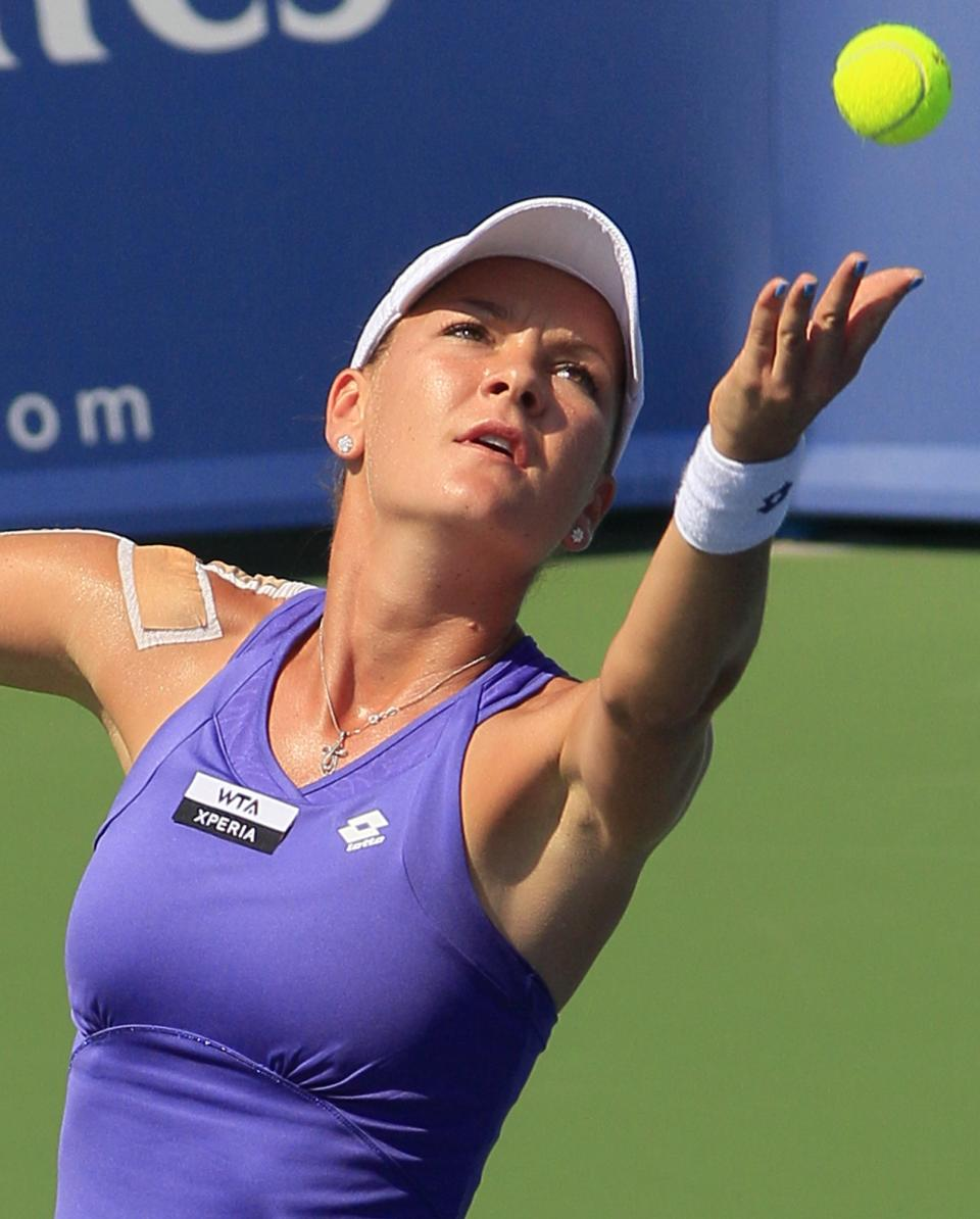 Agnieszka Radwanska, from Poland, serves against Sloane Stephens during a match at the Western & Southern Open tennis tournament, Thursday, Aug. 16, 2012, in Mason, Ohio. (AP Photo/Al Behrman)