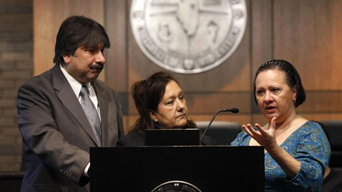 Family members of Kathleen Savio, from left, brother Frank, sisters Anna Marie Doman and Susan Doman, talk to reporters after Judge Edward Burmila rejected a defense retrial motion for Drew Peterson and then sentenced Peterson to 38 years in prison for the 2004 murder of his third wife Kathleen, Thursday, Feb. 21, 2013, in Joliet, Ill. (AP Photo/Charles Rex Arbogast)
