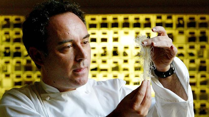 FILE - In this Dec. 5, 2003 file photo, Spanish chef Ferran Adria examines ingredients in his kitchen workshop in Barcelona, Spain. Spain's famed chef Ferran Adria says the wine cellar of his former restaurant, elBulli is to be auctioned to raise funds for his new project, the elBulli Foundation.  (AP Photo/Bernat Armangue, File)