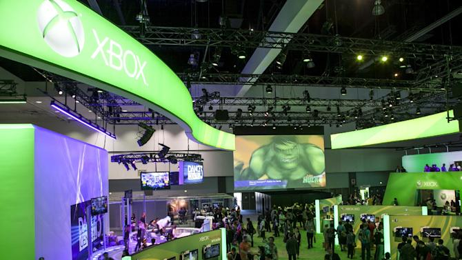 Show attendees walk past Microsoft XBox booth at E3 2012 in Los Angeles, Tuesday, June 5, 2012. The Electronic Entertainment Expo (E3), the premier convention for the computer and video game industry, is returning once again to Los Angeles for its annual gathering from June 5-7. (AP Photo/Damian Dovarganes)