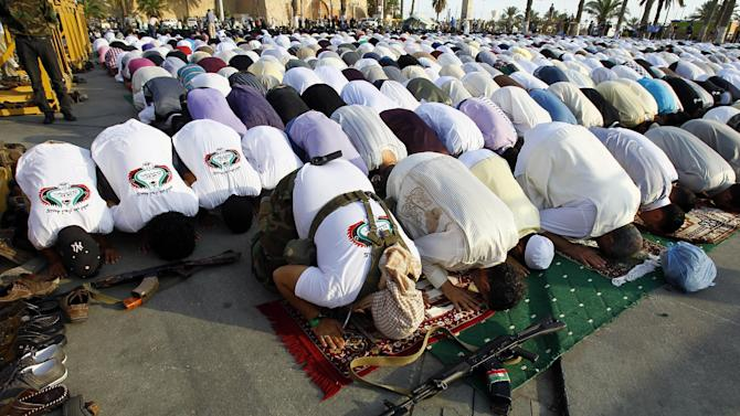 Libyan muslims pray in Green Square, renamed Martyr's Square, during the morning Eid prayer, marking the end of Ramadan and to celebrate victory over embattled Moammar Gadhafi, inTripoli, Libya, Wednesday, Aug. 31, 2011. (AP Photo/Francois Mori)