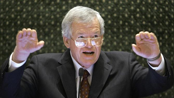 In this March 5, 2008, file photo, former U.S. House Speaker Dennis Hastert speaks to lawmakers on the Illinois House of Representatives floor at the state Capitol in Springfield, Ill. Federal prosecutors have indicted Thursday, May 28, 2015, the former U.S. House Speaker on bank-related charges. (AP Photo/Seth Perlman, File)