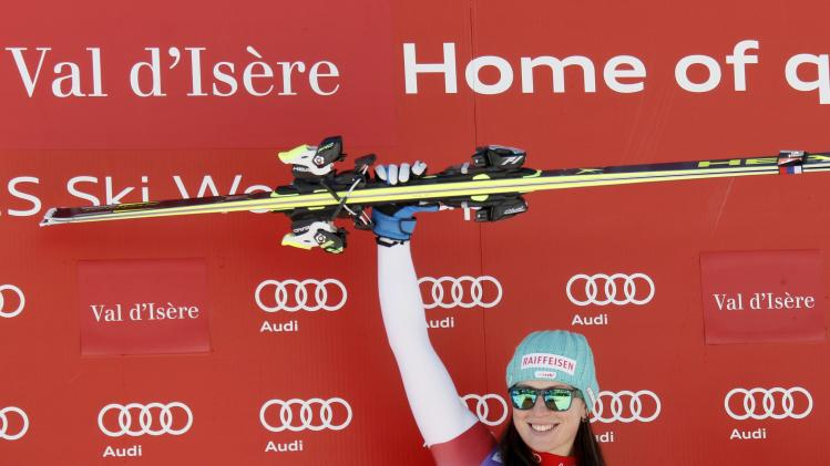 Kaufmann-Abderhalden of Switzerland reacts on the podium after winning the Women's World Cup Downhill skiing race in Val d'Isere
