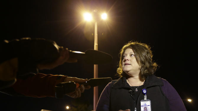 Federal Way Police spokeswoman Cathy Schrock talks to reporters about an overnight shooting that she said left five people dead, Monday, April 22, 2013, at an apartment complex in Federal Way, Wash. (AP Photo/Ted S. Warren)