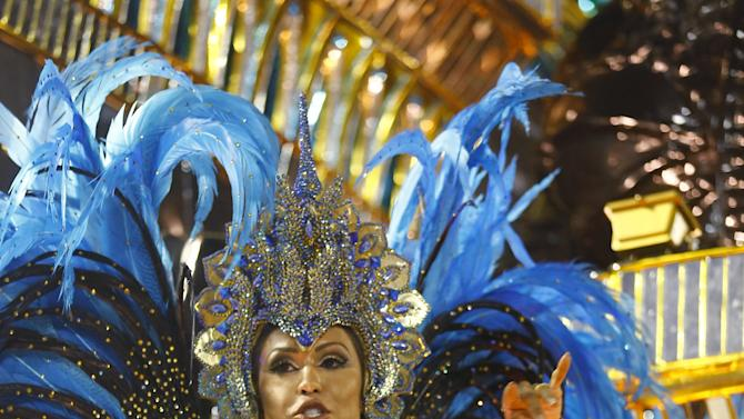 A reveller of Portela samba school performs during the carnival parade at the Sambadrome in Rio de Janeiro