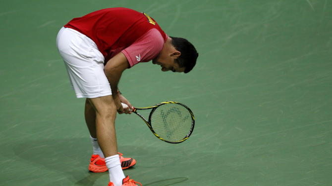 Spain's Nicolas Almagro reacts after losing a point to Czech Republic's Tomas Berdych during their Davis Cup finals tennis singles match in Prague, Czech Republic, Friday, Nov. 16, 2012. (AP Photo/ Marko Drobnjakovic)