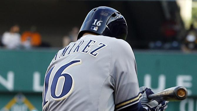 Milwaukee Brewers' Aramis Ramirez is hit by a pitch by Pittsburgh Pirates starter Gerrit Cole with the bases loaded in the first inning of a baseball game Friday, June 28, 2013, in Pittsburgh. Brewers' Norichika Aoki scored on the play. (AP Photo/Keith Srakocic)