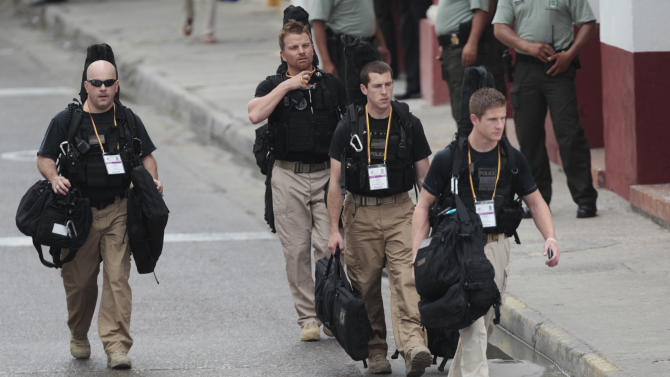 U.S. secret service agents walk around the Convention Center in Cartagena, Colombia, prior to the opening ceremony of the 6th Summit of the Americas at the Convention Center in Cartagena, Colombia, Saturday, April 14, 2012.  Last Thursday, a dozen secret service agents sent to provide security for U.S. President Barack Obama, were relieved from duty and replaced with other agency personnel after an incident of alleged misconduct. (AP Photo/Fernando Llano)