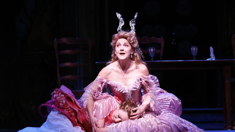 "This theater image released by Sam Rudy Media Relations shows Laura Osnes as Cinderella, left, and  Victoria Clark, as her Fairy Godmother, during a performance of ""Rodgers + Hammerstein's Cinderella on Broadway."" (AP Photo/Sam Rudy Media Relations, Carol Rosegg)"