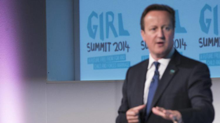 Britain's Prime Minister David Cameron speaks at the 'Girl Summit 2014' at the Walworth Academy in London