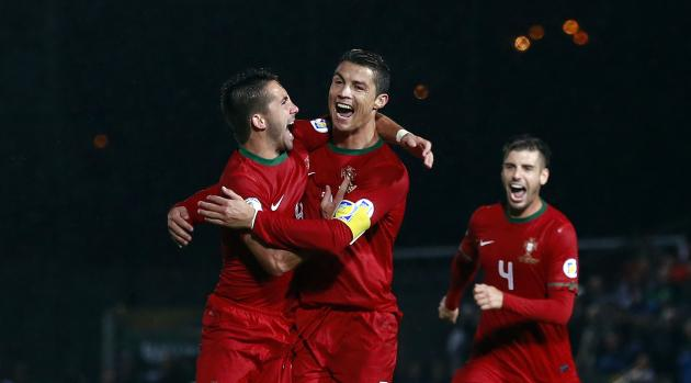Portugal's Ronaldo celebrates with teammates after scoring against Northern Ireland during their World Cup qualifying soccer match in Belfast.