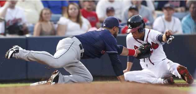 Indians third baseman Aviles tags out Braves runner Simmons on a fielders choice in the third inning during their MLB inter-league baseball game in Atlanta