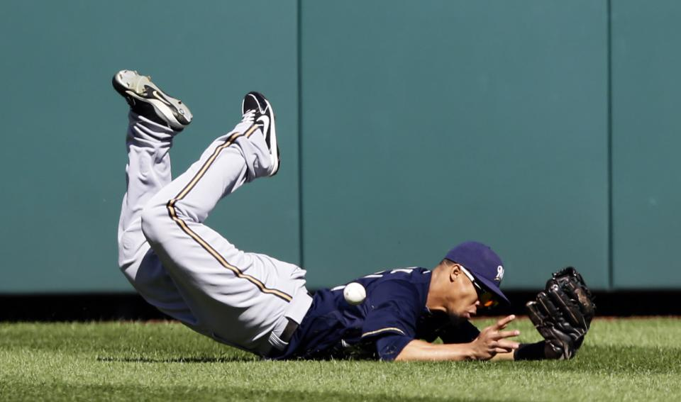 Milwaukee Brewers center fielder Carlos Gomez misses a ball hit by Washington Nationals' Jayson Werth, who had a two RBI double on the play, during the fourth inning of a baseball game, Monday, Sept. 24, 2012, in Washington. The Nationals won 12-2. (AP Photo/Alex Brandon)