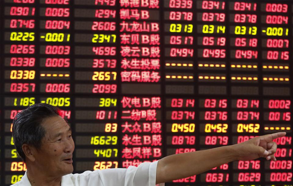 An investor gestures in front of the stock price monitor at a private securities company in Shanghai, China, Wednesday Sept. 5, 2012. Weaker-than-expected U.S. manufacturing figures, just days after China announced its own production slowdown, sent Asian stock markets down Wednesday. (AP Photo)