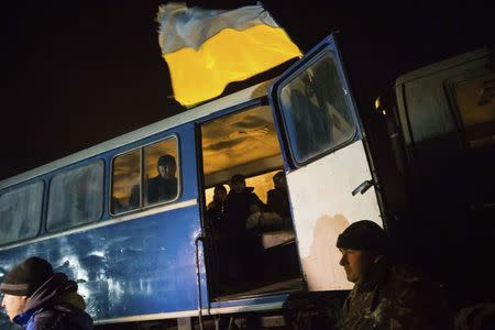 Ukrainian prisoners-of-war, sit inside a bus as they return home after being exchanged for pro-Russian separatist prisoners, in Kiev